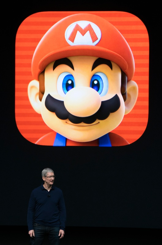 Apple CEO Tim Cook introduces a Super Mario game during an Apple event inside Bill Graham Civic Auditorium in San Francisco, California on September 07, 2016. Apple is expected to introduce a new iPhone and perhaps a second-generation smartwatch as it polishes its lineup of devices to shine during the year-end shopping season. The rumor mill has been grinding away with talk of iPhone 7 models that will boast faster chips, more sophisticated cameras, and improved software while doing away with jacks for plugging in wired headphones. / AFP PHOTO / Josh Edelson